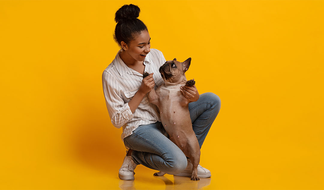 Woman dancing with dog